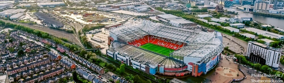 BANNER UK MANCHESTER AUGUST 07 2017 Old Trafford is a football stadium Greater Manchester England and the home of Manchester United. Aerial View of Iconic Football Ground